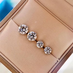 Tiffany Solitaire single diamond earrings four prong earrings