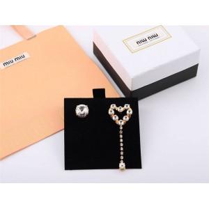 miumiu asymmetric heart-shaped imitation crystal decorative earrings 5JO612